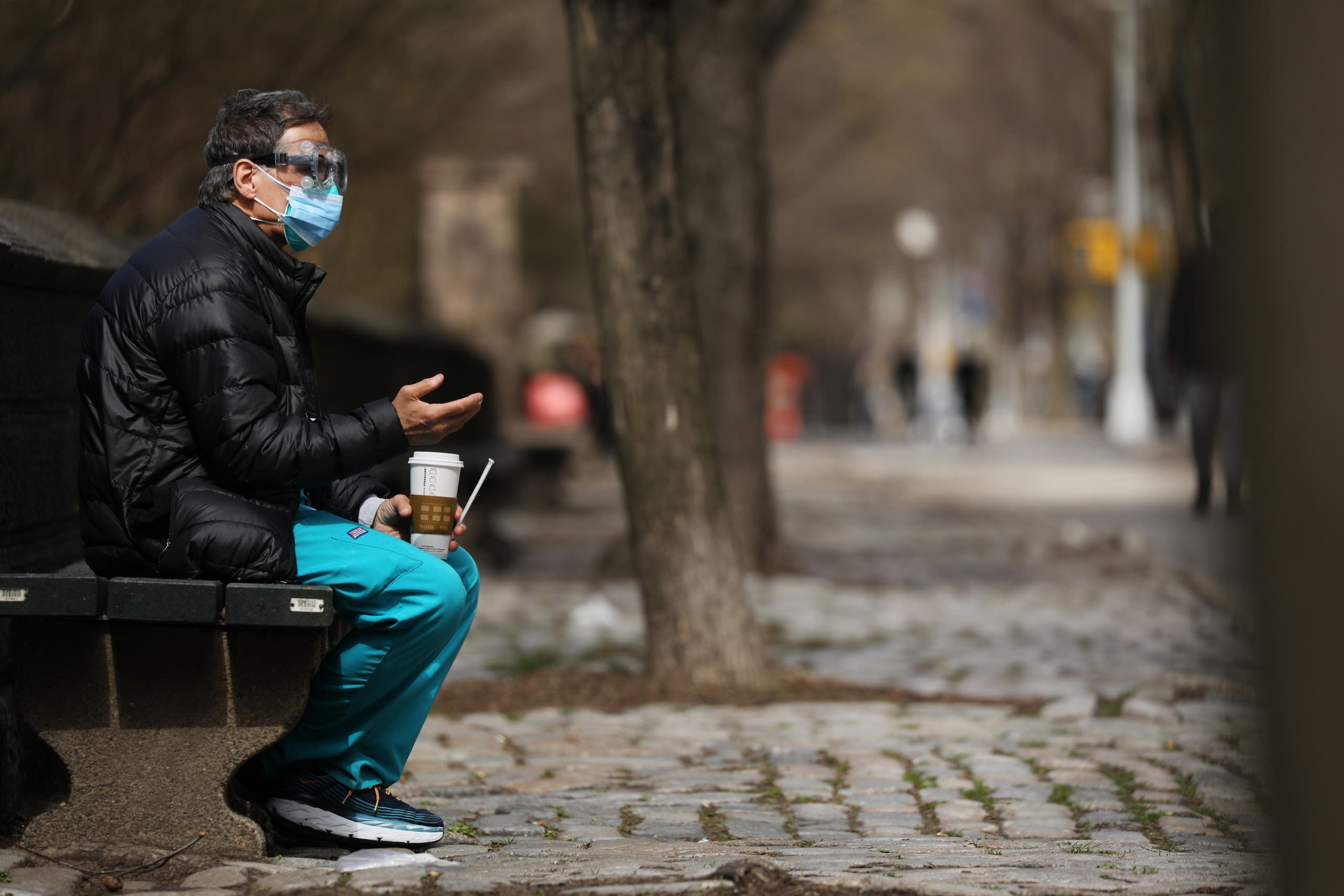 A medical worker takes a break outside of Mount Sinai Hospital amid the coronavirus pandemic on April 01, 2020 in New York City. (AFP)