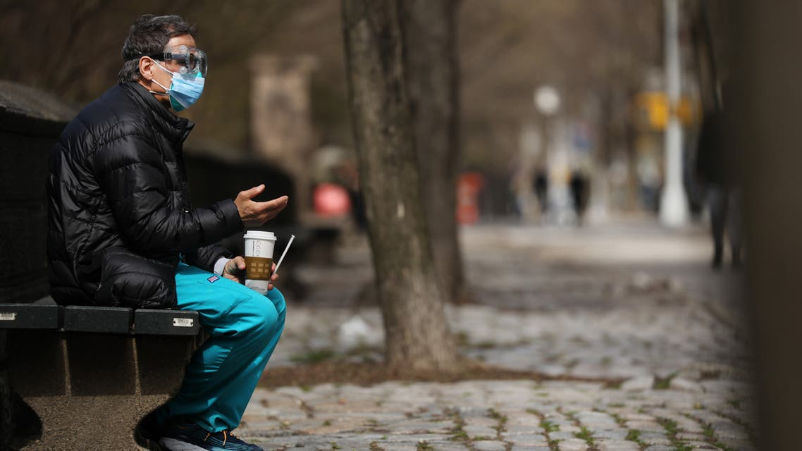 NEW YORK, NY APRIL 01: A medical worker takes a break outside of Mount Sinai Hospital amid the coronavirus pandemic on April 01, 2020 in New York City. Hospitals in New York City, the nation's current epicenter of the COVID-19 outbreak, are facing shortages of beds, ventilators and protective equipment for medical staff. Currently, over 75, 000 New Yorkers have tested positive for COVID-19. Spencer Platt/Getty Images/AFP
