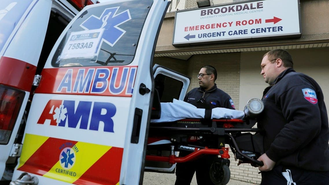 E.M.Ts load a bed into an ambulance outside the Brookdale Hospital Medical Center during the coronavirus disease (COVID-19) outbreak in Brooklyn, New York City.  (Reuters)