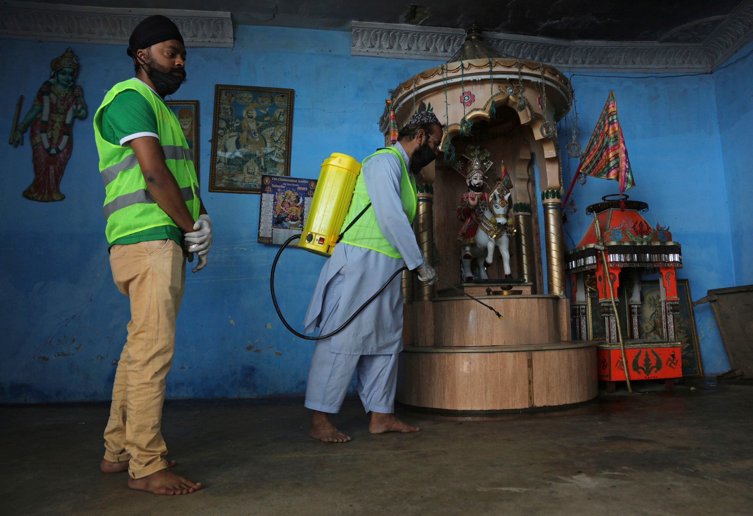 A volunteer disinfects the Hindu temple to contain the outbreak of the coronavirus, in Karachi, Pakistan on March 30, 2020. (AP)