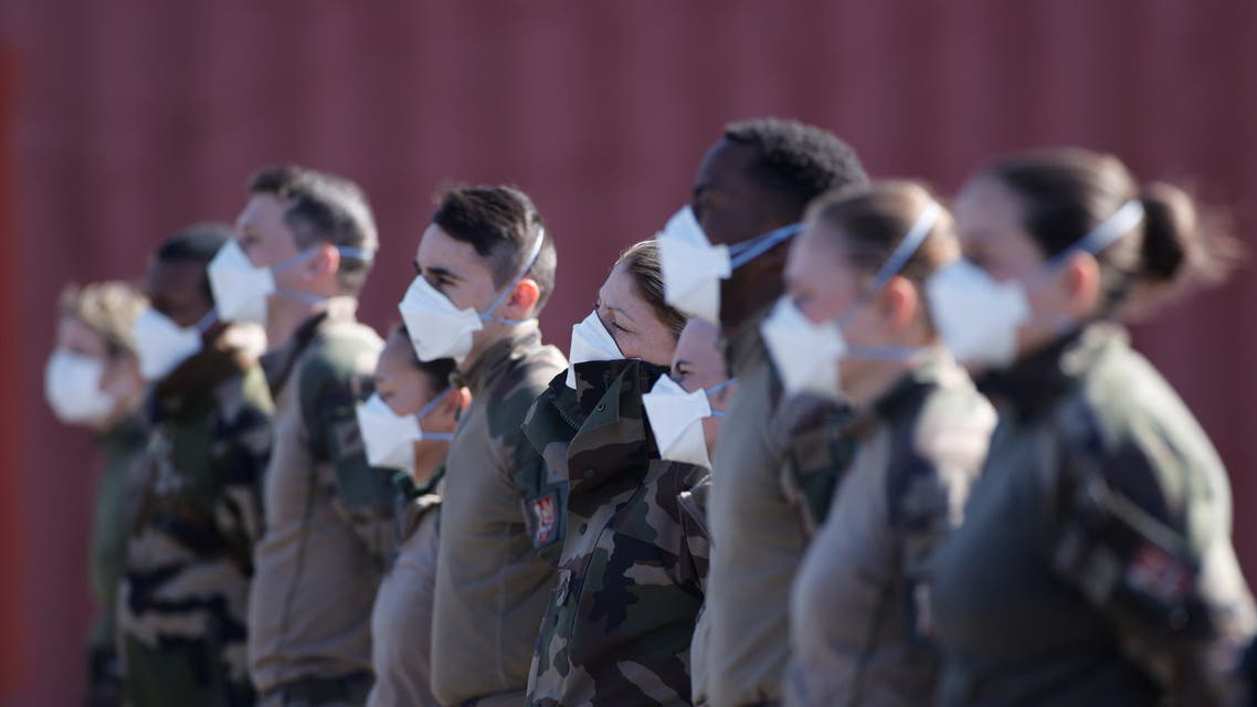 French soldiers, wearing protective face masks, attend a briefing at a miitary field hospital near Mulhouse hospital as France faces an aggressive progression of the coronavirus disease (COVID-19), March 23, 2020. REUTERS/Christian Hartmann