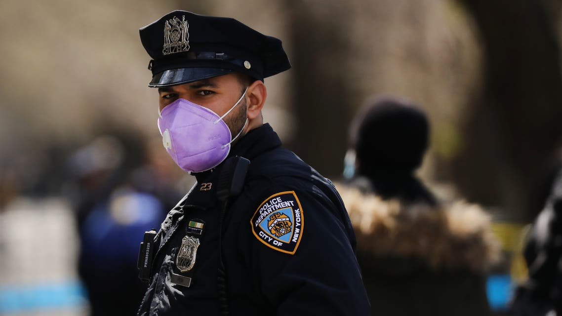 NEW YORK, NY APRIL 01: A police officer stands outside of Mount Sinai Hospital amid the coronavirus pandemic on April 01, 2020 in New York City. Hospitals in New York City, the nation's current epicenter of the COVID-19 outbreak, are facing shortages of beds, ventilators and protective equipment for medical staff. Currently, over 75, 000 New Yorkers have tested positive for COVID-19. Spencer Platt/Getty Images/AFP