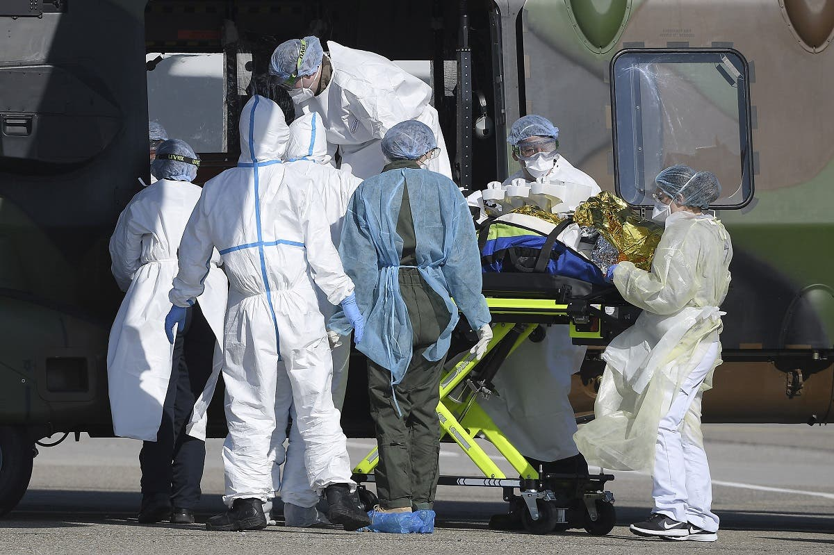 Medical staff push a patient inside a French medical helicopter in Strasbourg, on March 30, 2020, to be evacuated to a German hospital amid the coronavirus outbreak. (AFP)