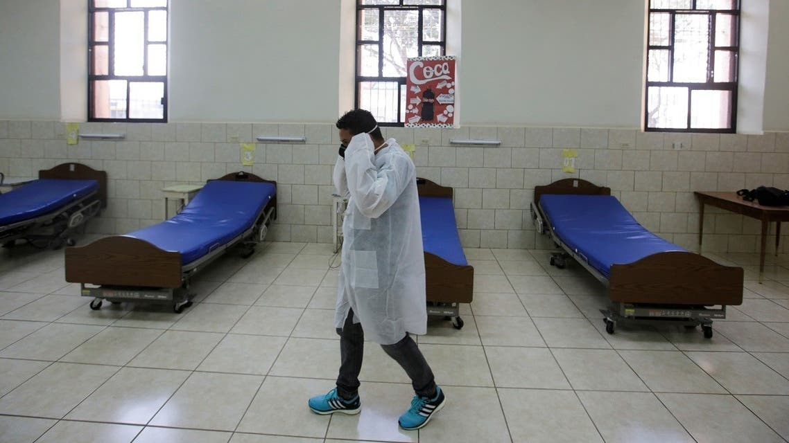 A hospital worker is seen among hospital beds prepared in anticipation of patients with coronavirus disease (COVID-19) at San Felipe Hospital, in Tegucigalpa, Honduras. (Reuters)
