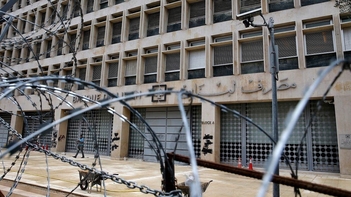 A worker walks outside the Lebanese Central Bank that has been shut down as part of the preventive measures against the coronavirus, in Beirut, Lebanon. (File photo: AP)
