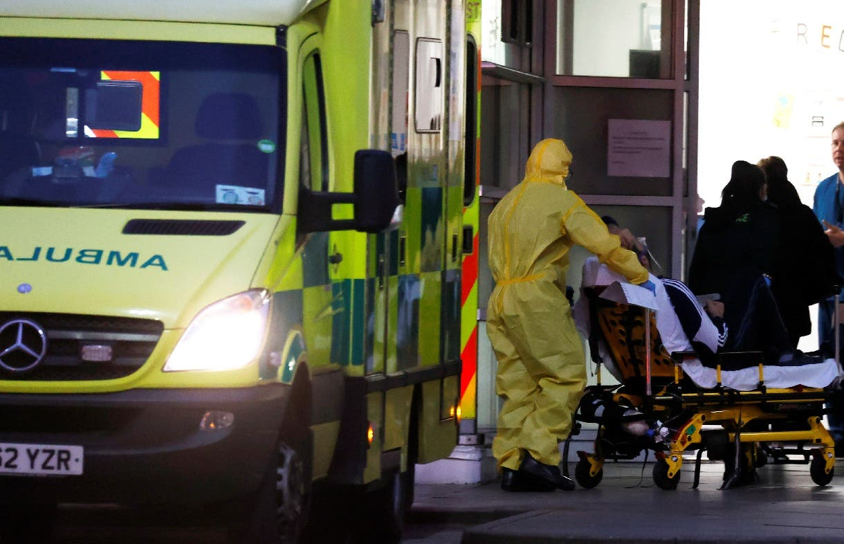 A medical worker pushes a patient on a stretcher outside Royal Liverpool University Hospital as the spread of the coronavirus disease (COVID-19) continues, Liverpool, Britain, April 2, 2020. (Reuters)