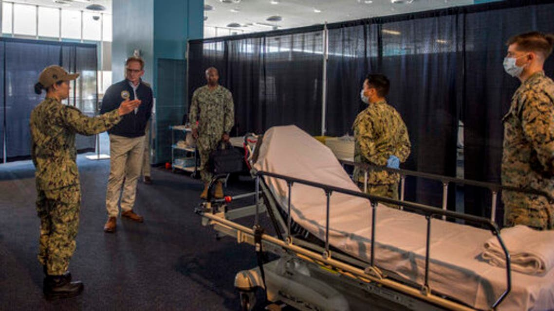 US Navy acting Secretary Thomas B. Modly is toured through the patient transfer process at the Military Sealift Command hospital ship USNS Mercy (T-AH 19), March 31, 2020. (US Navy via AP)
