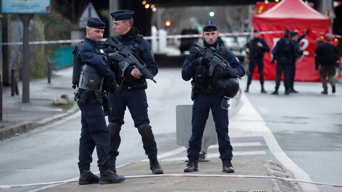 French police secure an area after a knife attack in a public park in Villejuif. (Reuters)