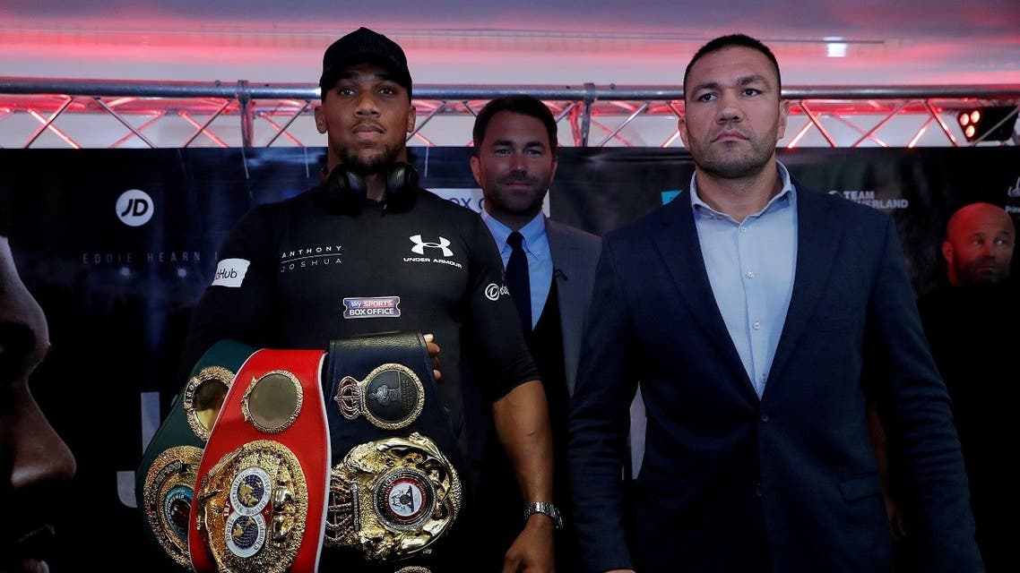 Anthony Joshua and Kubrat Pulev pose during a press conference. (Action Images via Reuters)