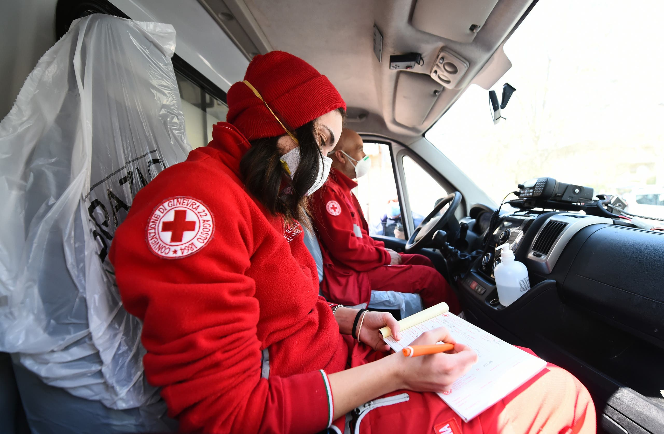 Members of the Red Cross sit inside a vehicle outside the Molinette Hospital on Palm Sunday, during the coronavirus outbreak, in Turin, Italy April 5, 2020. (Reuters)