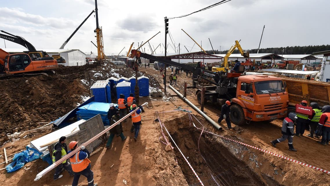 Workers build a new Covid-19 Hospital for patients infected with the novel coronavirus, outside Moscow, on April 1, 2020, as the city is under lockdown in order to stop the spread of the COVID-19 outbreak.