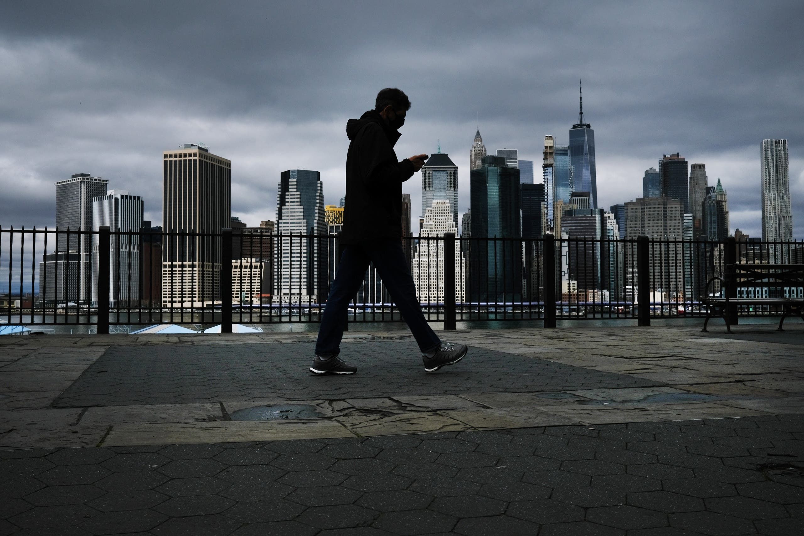 The Manhattan skyline stands in the distance as people try to get some time outside in Brooklyn on April 04, 2020 in New York City. (AFP)