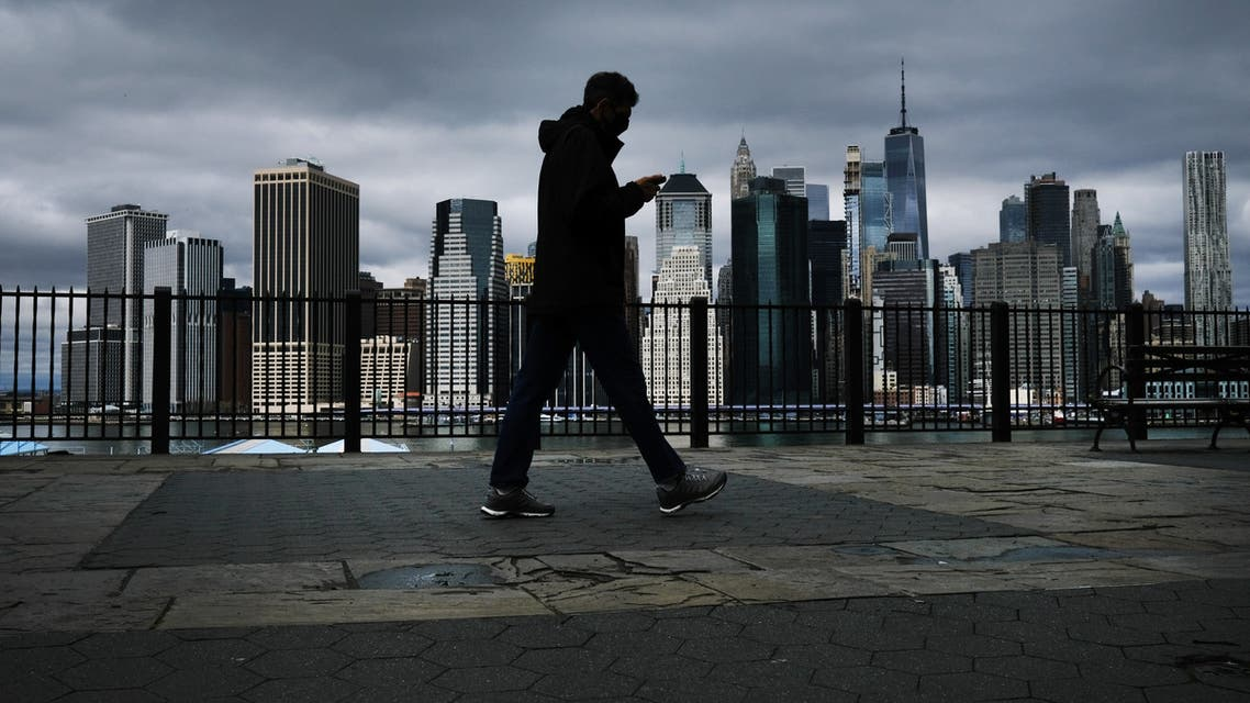 he Manhattan skyline stands in the distance as people try to get some time outside in Brooklyn on April 04, 2020 in New York City. (AP)