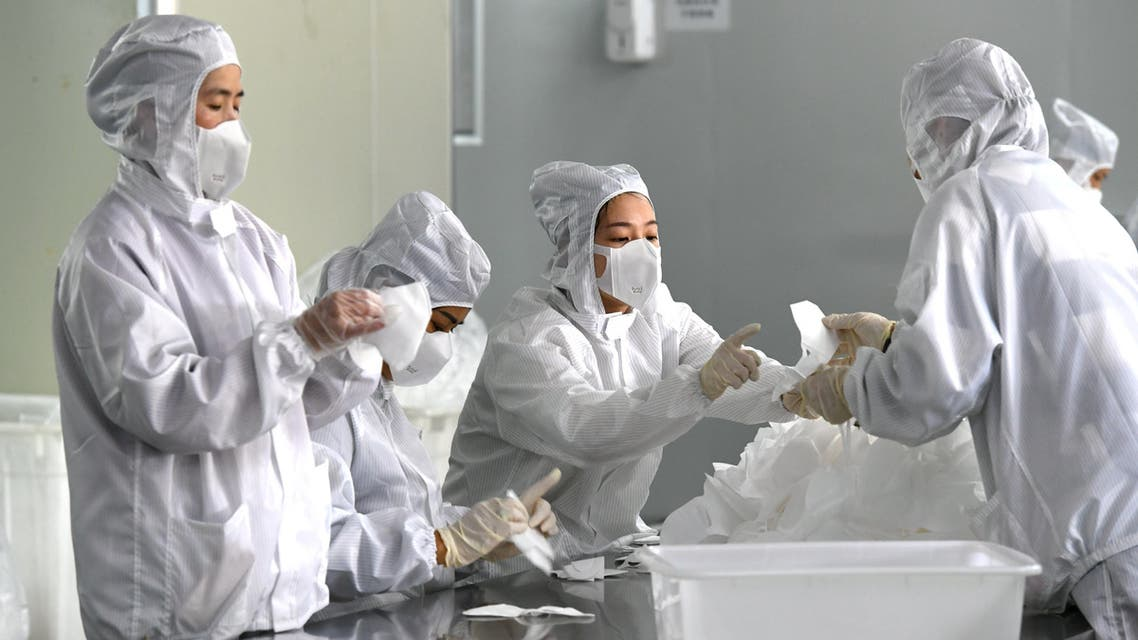 Employees work in a face mask factory in China. (File photo: Reuters)