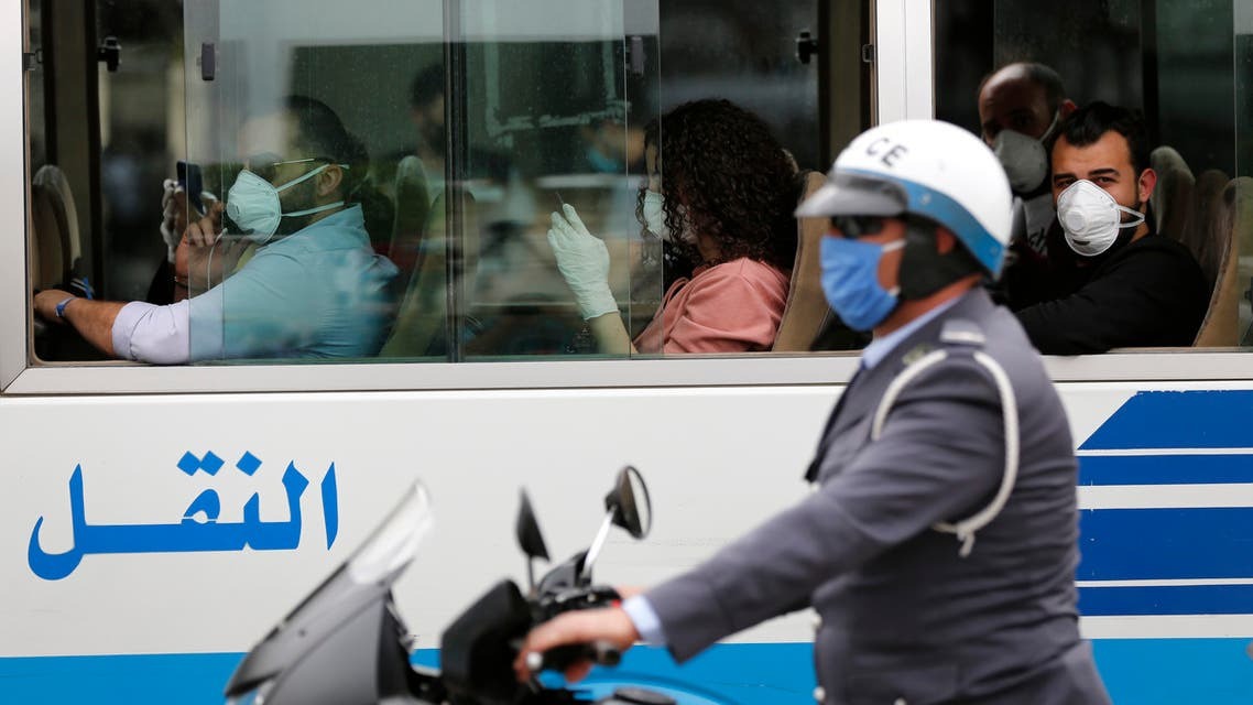 A traffic policeman escorts a bus carrying Lebanese passengers who were stuck in Saudi Arabia, after arriving to Rafik Hariri Airport in Beirut, Lebanon on April 5, 2020. (AP)