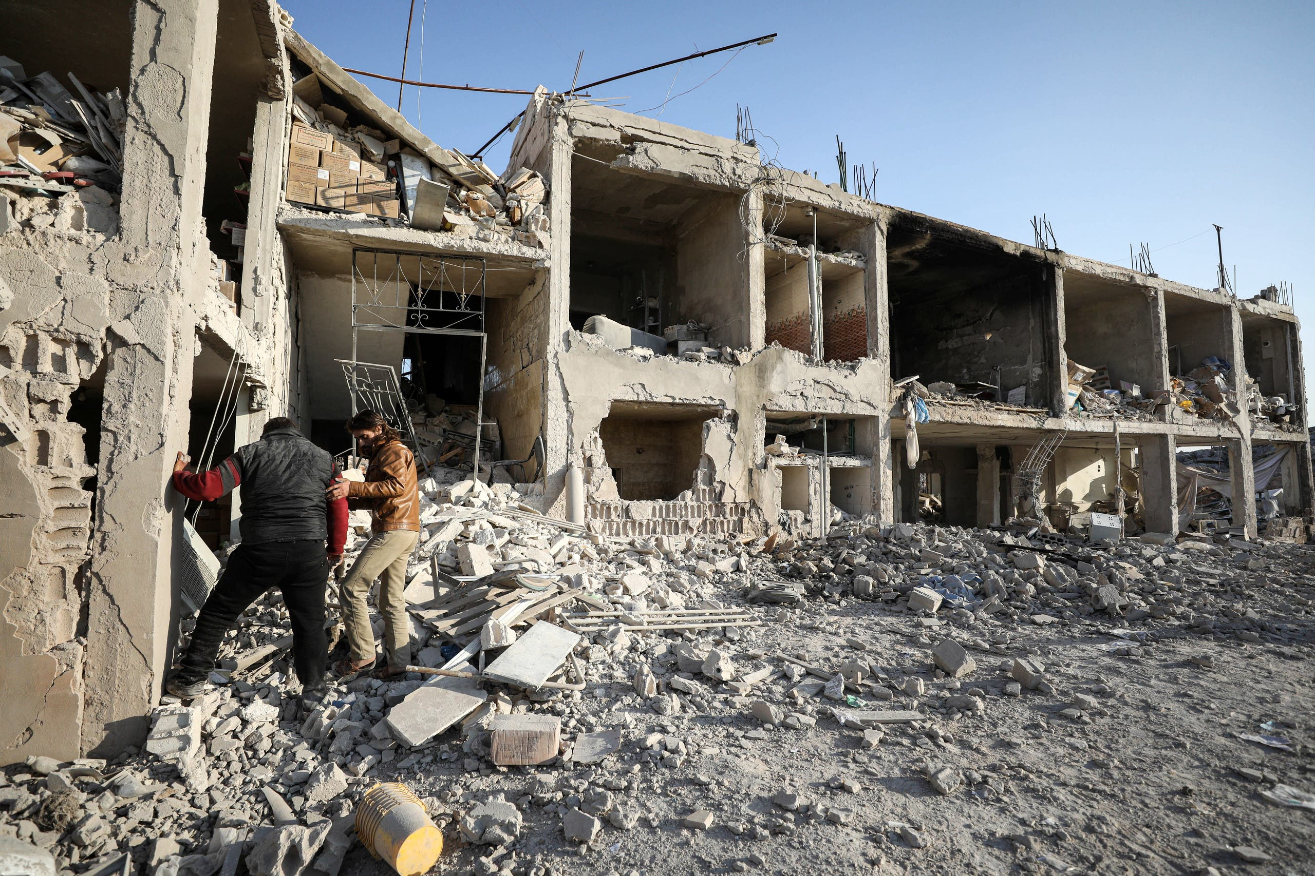 Men inspect the rubble of a hospital that was reportedly hit by a reported air strike in the Syrian village of Shinan, about 30 kilometres south of Idlib in the northwestern Idlib province, on November 6, 2019.