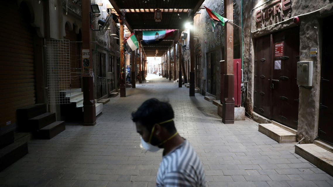 A man wearing a protective face mask walks through the deserted Barajeel Souq, following the outbreak of the coronavirus disease (COVID-19), in old Dubai, United Arab Emirates, March 31, 2020. (Reuters)