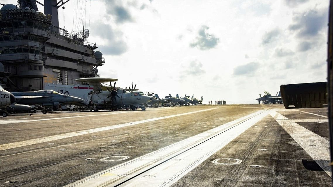 Planes are parked on the flight deck of the US Navy aircraft carrier USS Theodore Roosevelt in the Philippine Sea March 18, 2020. (Reuters)