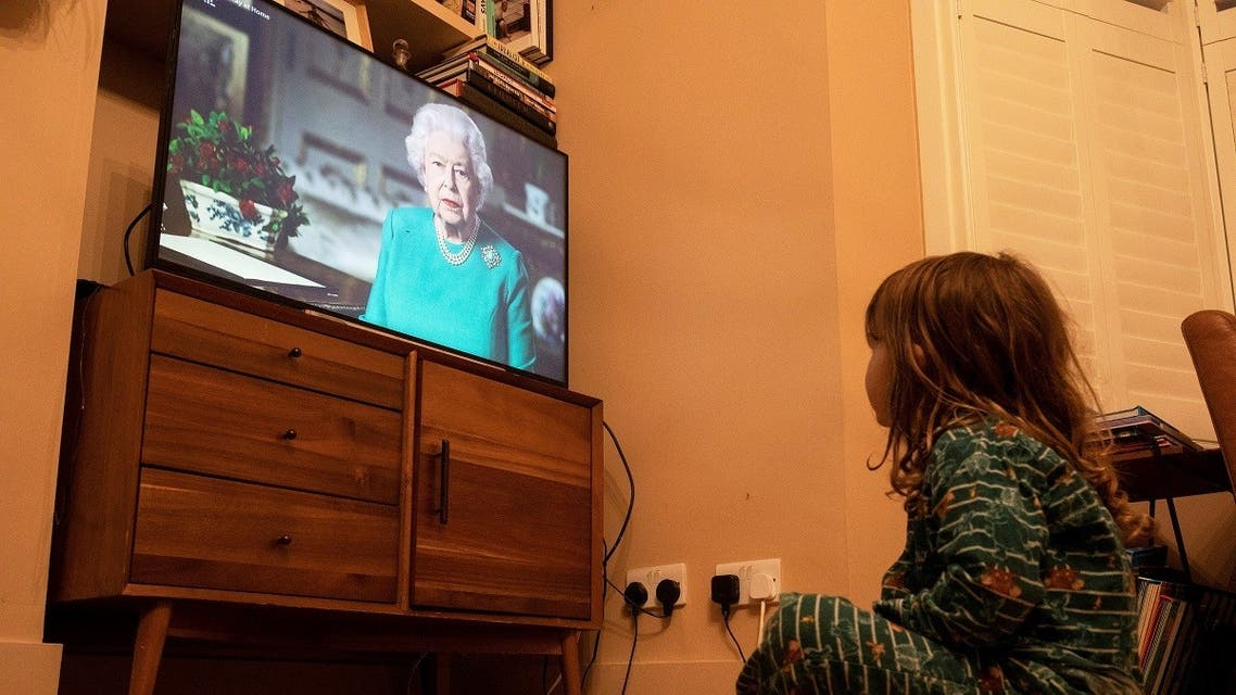 Isaac (4) watches Britain's Queen Elizabeth II during a televised address to the nation, as the spread of the coronavirus disease (COVID-19) continues, London, Britain. (Reuters)