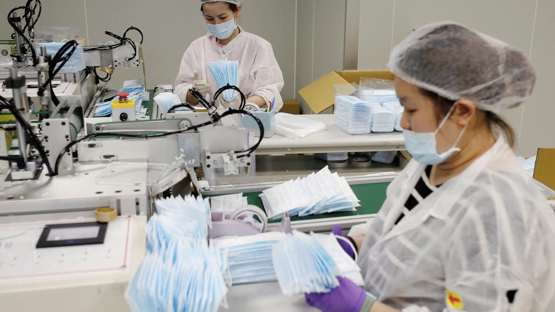 A worker packs surgical masks on the production line in a factory in Taoyuan, Taiwan April 6, 2020. REUTERS/Ann Wang