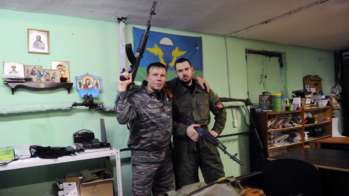 "(FILES) This file photo taken on February 28, 2015 shows members of the ""Russian Imperial Movement"", a nationalist group in Russia, volunteers of the self-declared Donetsk People's Republic Dmitry Gaydun nick-named Donskoy (R) and Sergei Zinchenko nick-named Shtrafbat posing for a picture with weapon simulators at a training base in Saint-Petersburg. The United States on April 6, 2020 branded a Russian far-right group as a foreign terrorist organization, the first time it has targeted white supremacists with tools regularly used against Islamist extremists. The State Department said that the Russian Imperial Movement runs paramilitary training camps in St. Petersburg and has drawn neo-Nazis from across the Western world."