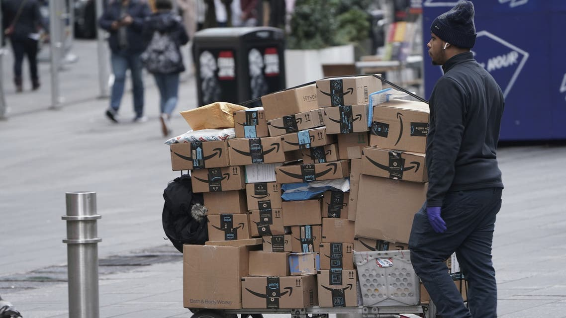 An Amazon delivery person walks in Times Square following the outbreak of Coronavirus, in the Manhattan borough of New York City. (Reuters)