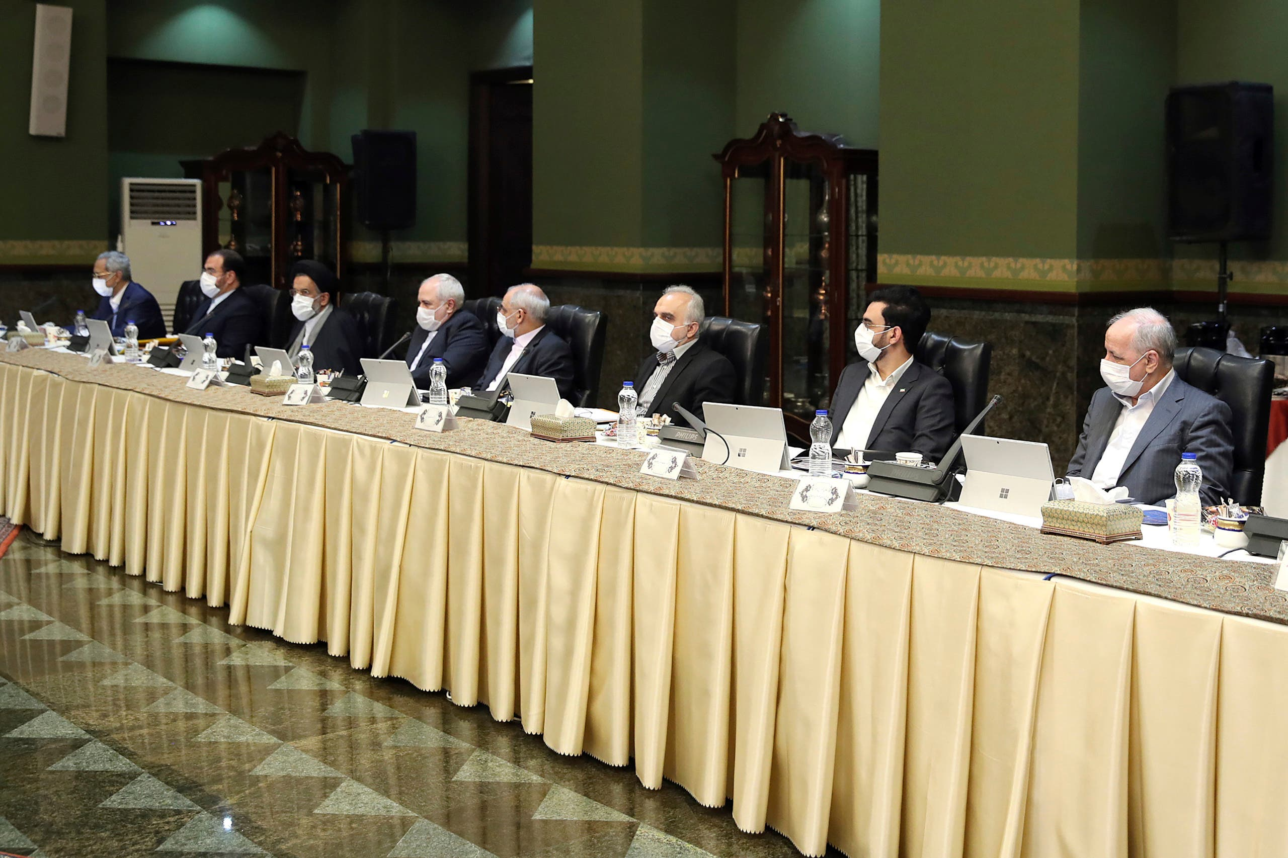 In this photo released by the official website of the Office of the Iranian Presidency, cabinet members wearing face masks attend their meeting in Tehran, Iran on March 18, 2020. (AP)