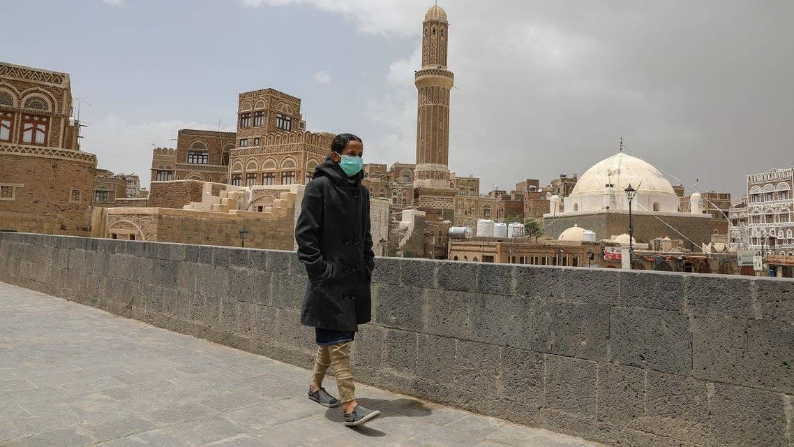 A girl wears a protective face mask amid fears of the spread of the coronavirus disease (COVID-19) in Sanaa. (Reuters)