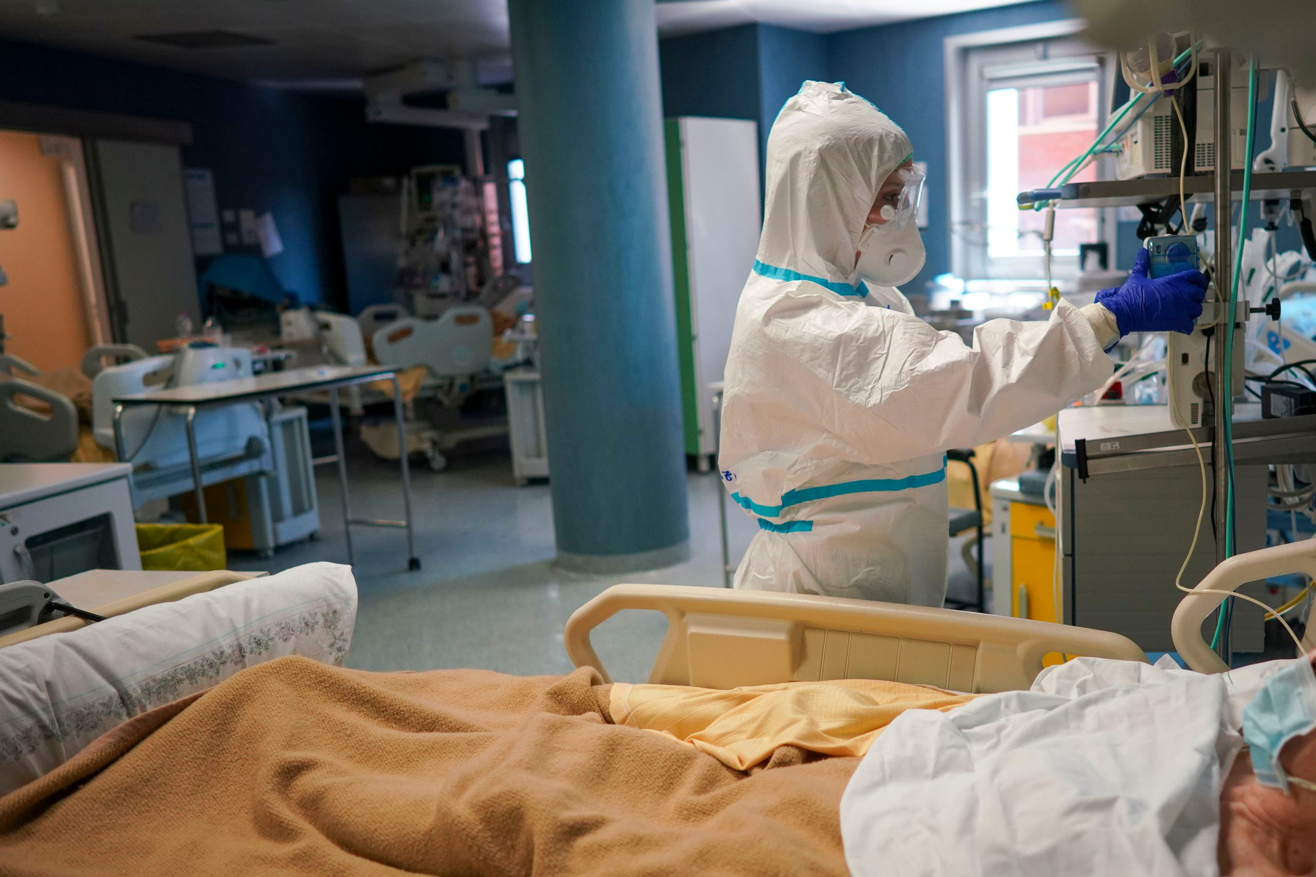 A medical staffer tends to a patient In the ICU unit of Rome's San Filippo Neri Hospital's Covid department on April 9, 2020. (AP)