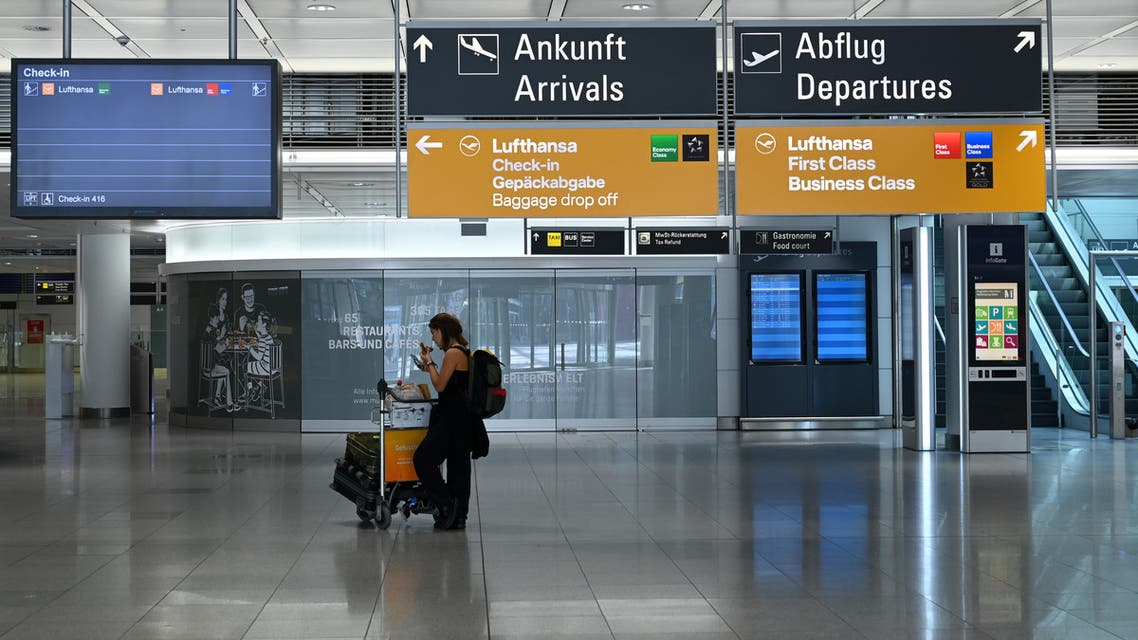 A lone passnager stands in an an empty terminal hall at the Franz-Josef-Strauss airport in Munich, southern Germany, on April 7, 2020 where just a few flights take off and land currently due to the coronavirus COVID-19 pandemic.