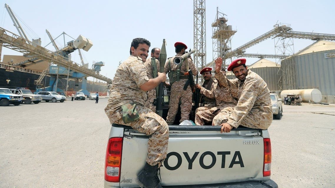 Yemen's Houthi militia ride in the back of vehicle during withdrawal from Saleef port in Hodeidah province. (Reuters)