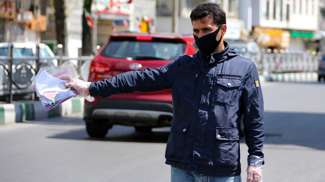 A Iranian man sells face masks on a street in the capital Tehran, during the novel coronavirus pandemic crisis, on April 5, 2020. The spread of the virus in Iran has slowed for the fifth day in a row, according to official figures released today by the authorities, who also announced plans for a gradual resumption of certain economic activities starting on April 11.