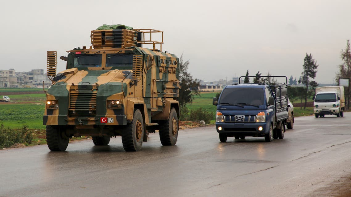 A Turkish military convoy drives on a highway linking Idlib to the Syrian Bab al-Hawa border crossing with Turkey on March 31, 2020.