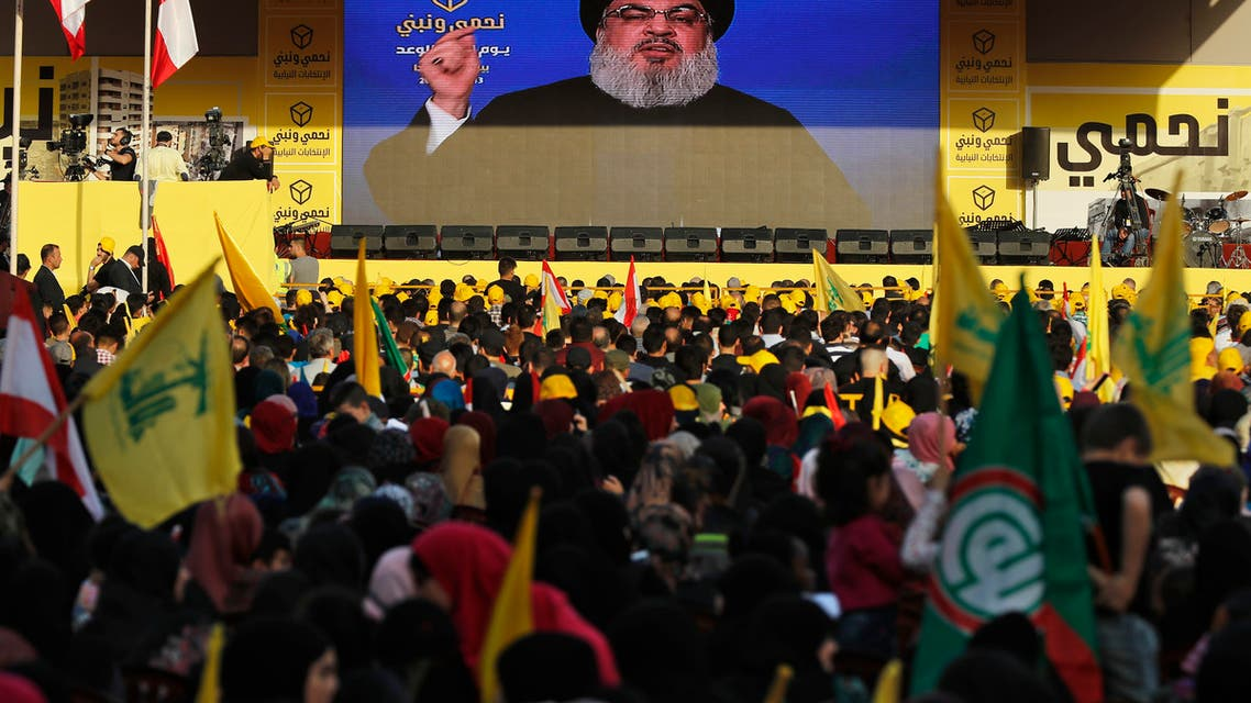 Hezbollah leader Sayyed Hassan Nasrallah delivers a broadcast speech through a giant screen during an election campaign in a southern suburb of Beirut on April 13, 2018. (AP)
