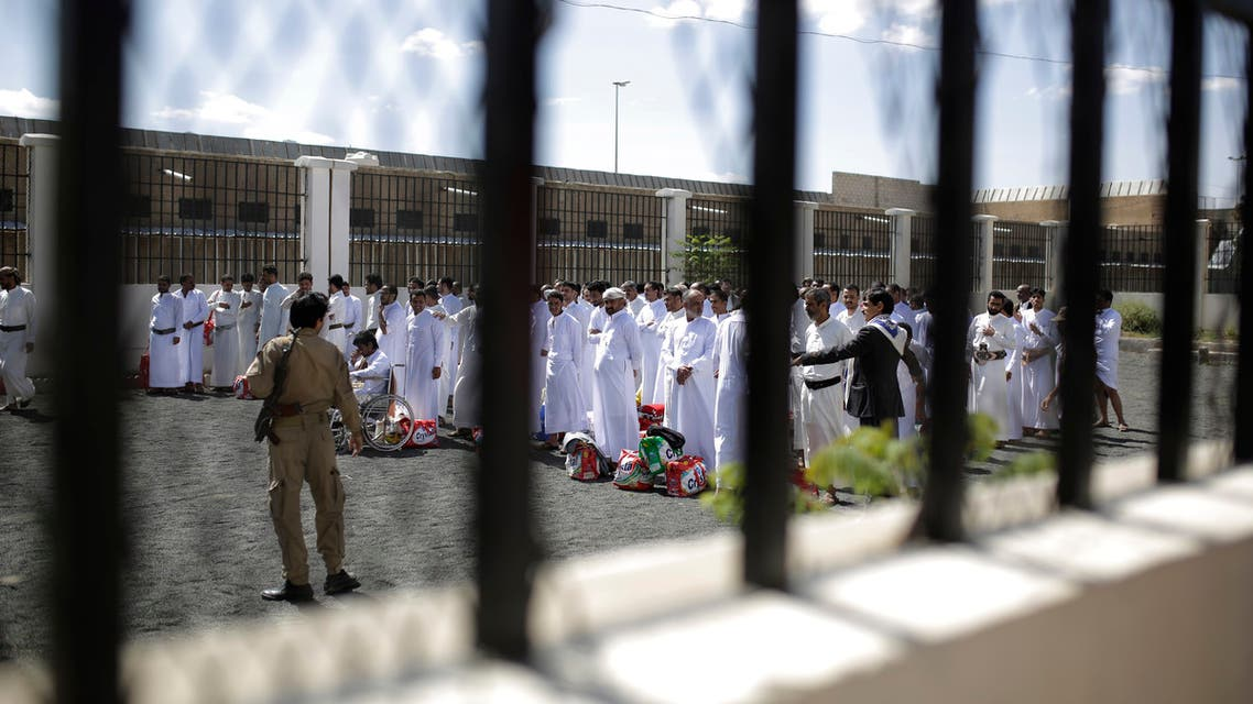 Yemeni detainees stand as they wait for their release from a prison controlled by Houthi rebels, in Sanaa, Yemen on Sept. 30, 2019. (AP)