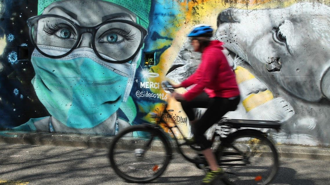 A graffiti representing a nurse by artist David S.I.D. Perez is pictured on a wall as part of a serie to pay tribute to essential workers during the coronavirus disease (COVID-19) outbreak in Gland, Switzerland. (Reuters)