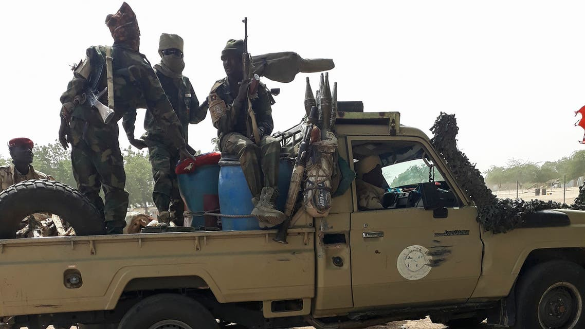 Soldiers of the Chad Army sit on the back of a Land Cruiser at the Koundoul market, 25 km from N'Djamena, on January 3, 2020, upon their return after a months-long mission fighting Boko Haram in neighbouring Nigeria. Chad has ended a months-long mission fighting Boko Haram in neighbouring Nigeria and withdrawn its 1,200-strong force across their common border, an army spokesman told AFP on January 4, 2020.