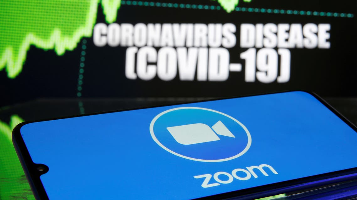 FILE PHOTO: FILE PHOTO: Zoom logo is seen in front of diplayed coronavirus disease (COVID-19) in this illustration taken March 19, 2020. REUTERS/Dado Ruvic/Illustration - RC20NF9U5BJ8/File Photo/File Photo