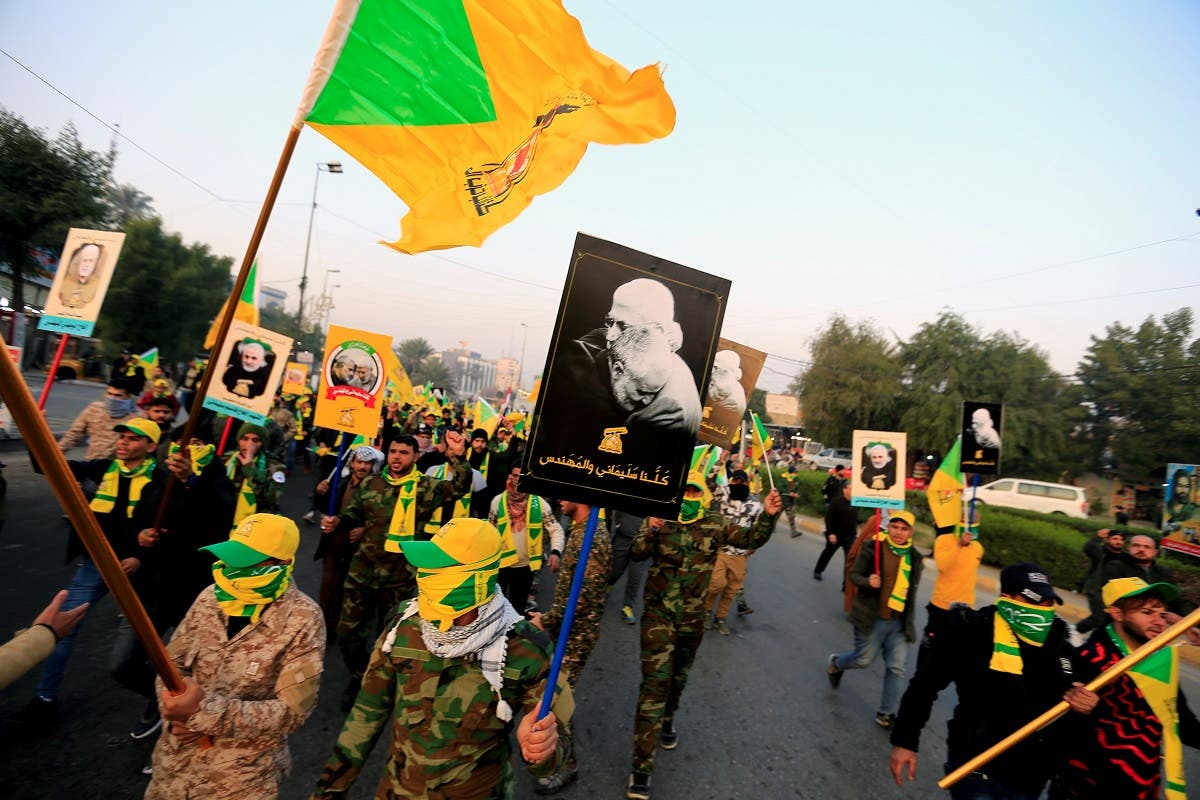 Kata'ib Hezbollah march in Baghdad ahead of the funeral of Abu Mahdi al-Mohandes, January 4, 2020. (Reuters)
