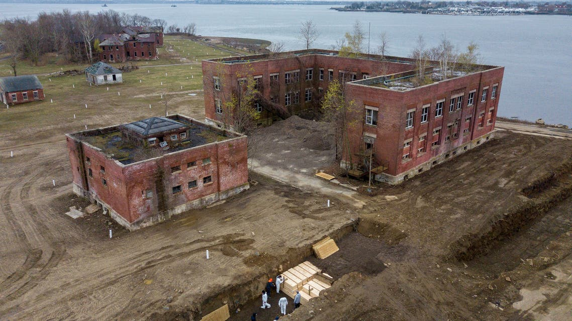 Drone pictures show bodies being buried on New York's Hart Island, where the department of corrections is dealing with more burials overall, amid the coronavirus disease (COVID-19) outbreak in New York City, U.S., April 9, 2020. REUTERS/Lucas Jackson