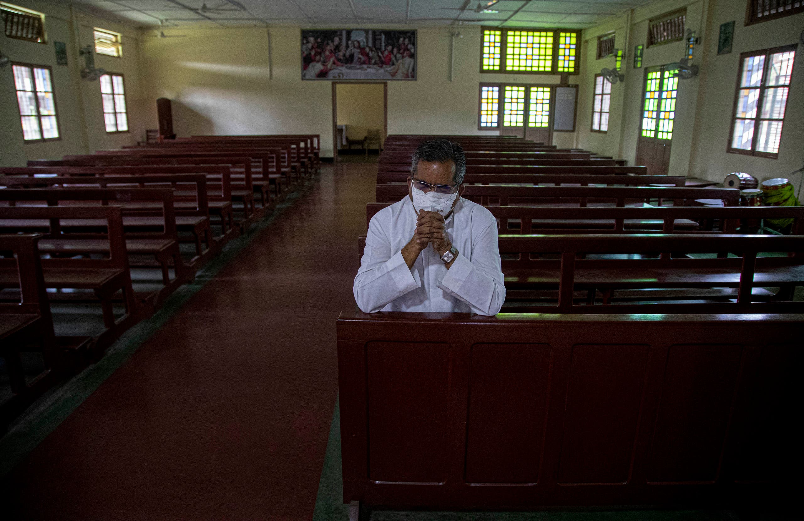 A Catholic priest V.M. Thomas prays in a church on Good Friday in Gauhati, India, Friday, April 10, 2020. (AP)