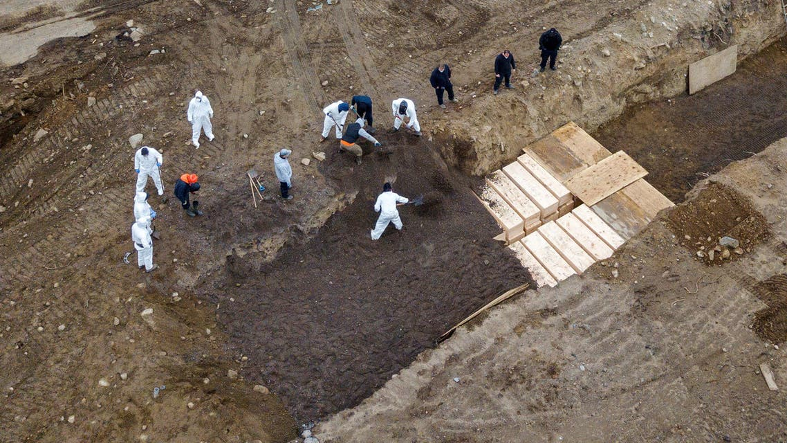 22  Drone pictures show bodies being buried on New York's Hart Island, where the department of corrections is dealing with more burials overall, amid the coronavirus disease (COVID-19) outbreak in New York City, U.S., April 9, 2020. REUTERS/Lucas Jackson