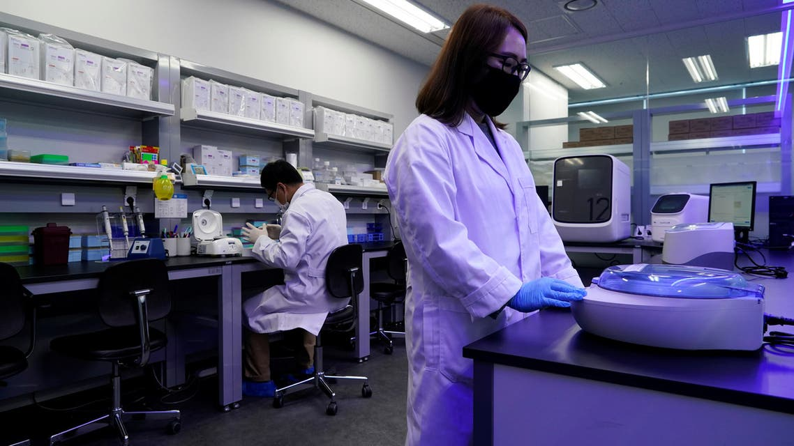 Researchers demonstrate samples of iLAMP Novel-Coronavirus Detection Kit at an iONEBIO's office in Seongnam, South Korea, March 26, 2020. Picture taken March 26 2020. REUTERS/Kim Hong-Ji