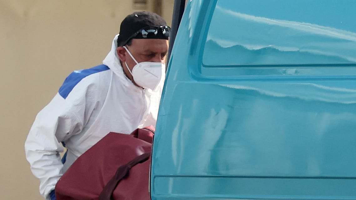 A worker is seen wearing protective clothing at a temporary mortuary in the car park of Central Jamia Mosque Ghamkol Sharif as the spread of the coronavirus disease (COVID-19) continues, Birmingham, Britain, April 10, 2020. REUTERS/Carl Recine