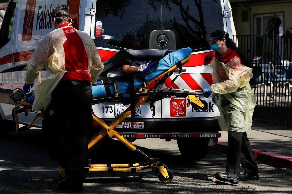 An ambulance crew transports a patient to Gateway Care and Rehabilitation Center in Hayward, California. (Reuters)