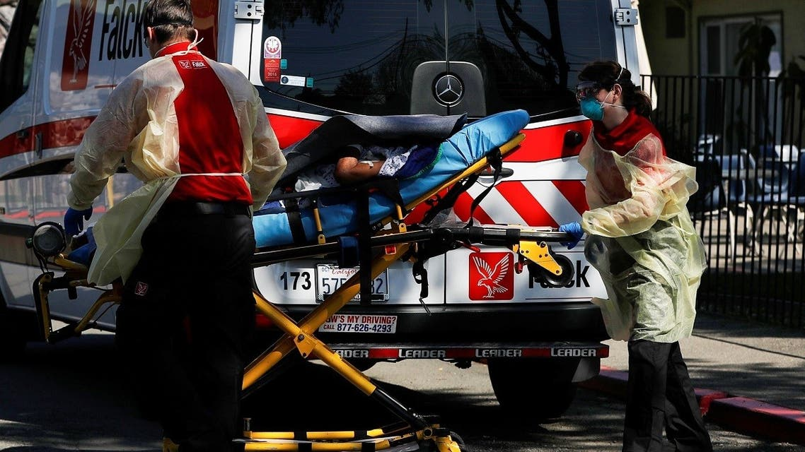 An ambulance crew transports a patient to Gateway Care and Rehabilitation Center, where 7 deaths and 65 confirmed cases of coronavirus disease (COVID-19) among its staff and patients were reported, in Hayward, California. (Reuters)