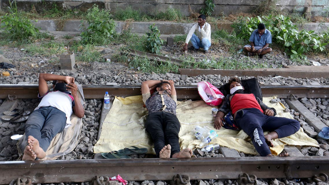 Migrant workers rest on a railway track during a 21-day nationwide lockdown to slow the spreading of coronavirus disease (COVID-19) in in Mumbai, India, April 2, 2020. (Reuters)