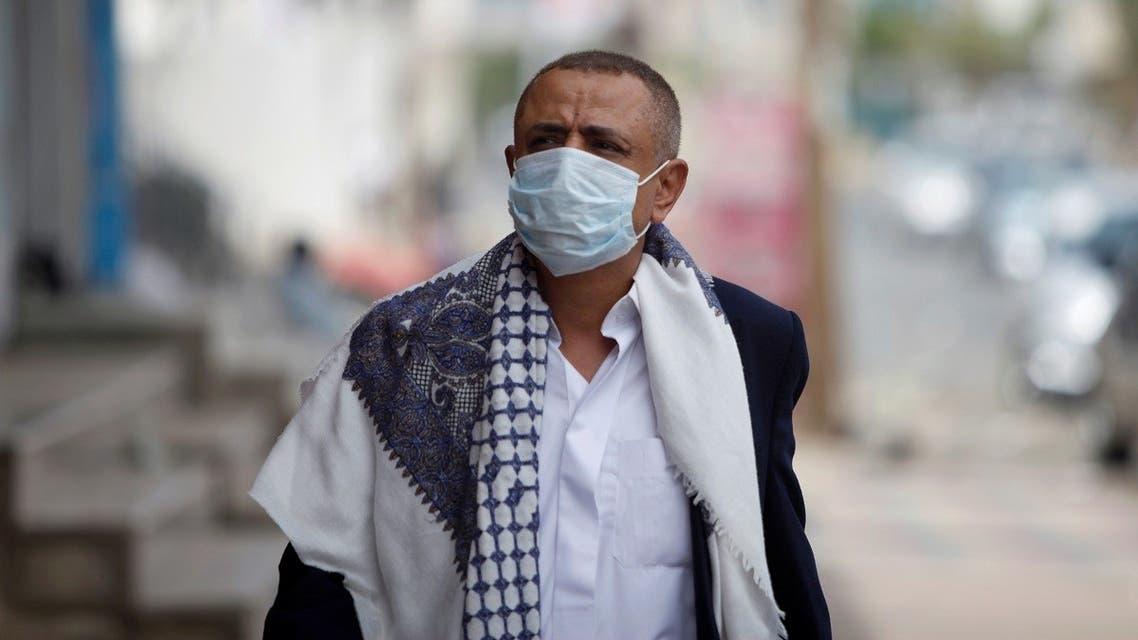 A man wearing a protective face mask walks in the street, amid fear of coronavirus disease (COVID-19), in Sanaa, Yemen. (Reuters)