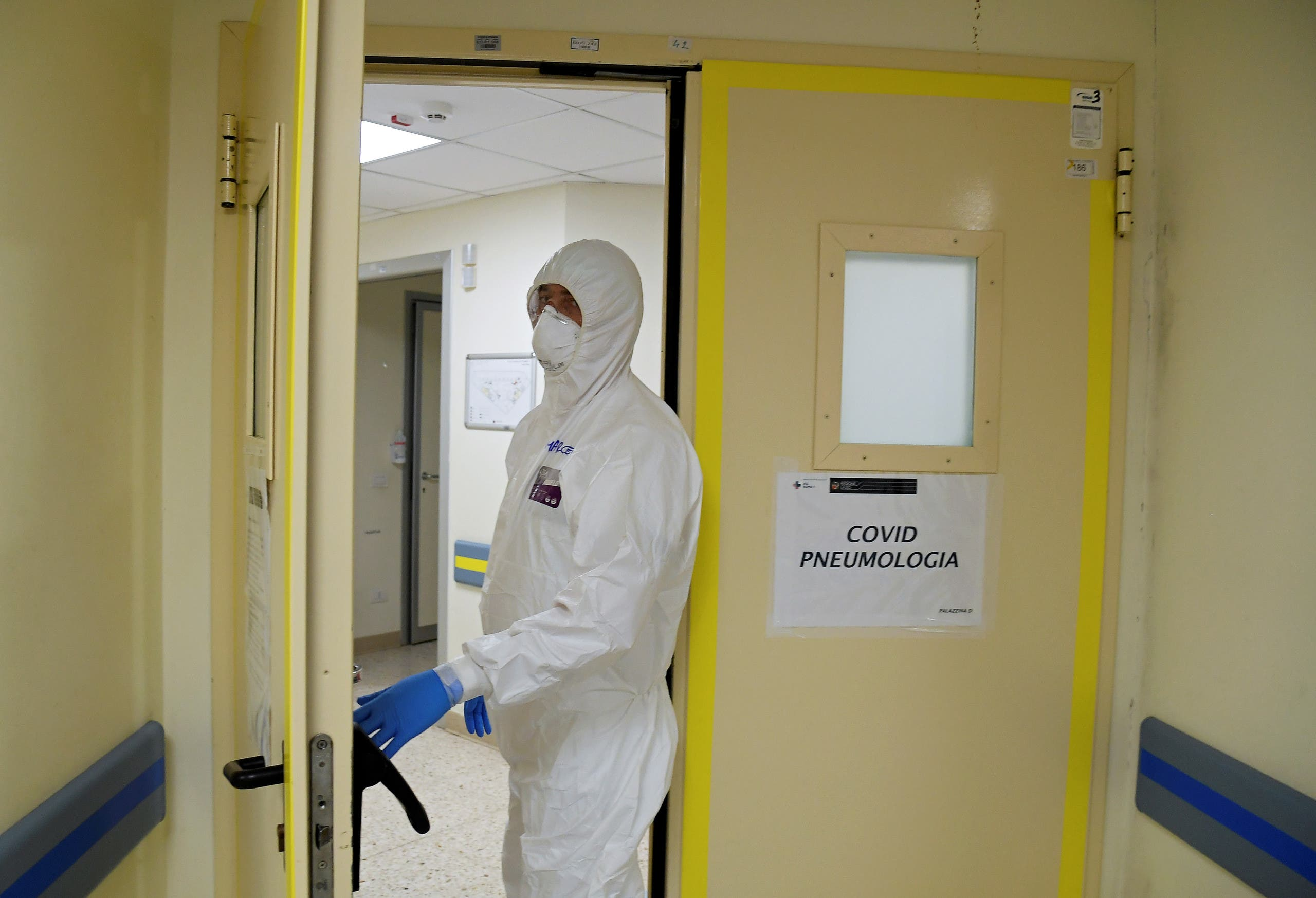 A member of the medical staff enters the coronavirus disease (COVID-19) unit at San Filippo Neri hospital in Rome, Italy April 9, 2020. (Reuters)