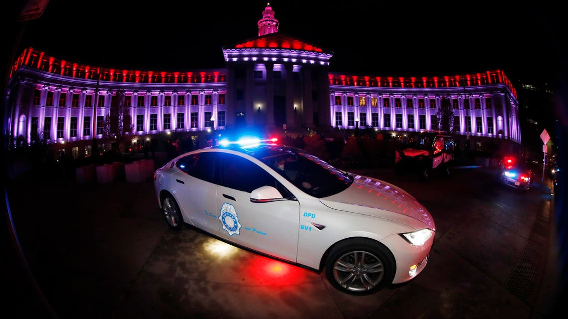 In this April 9, 2020, photo, a Tesla police car sits in front of the City/County Building after red and white lights were illuminated to show support and gratitude for first responders and medical personnel during the outbreak of the new coronavirus in Denver. The coronavirus pandemic that has crippled big-box retailers and mom and pop shops worldwide may be making a dent in illicit business, too. (AP)